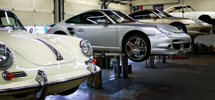 An image of four Porsches inside the shop